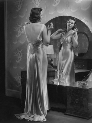 george-marks-woman-wearing-dress-looking-in-mirror